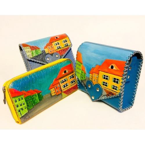 http://carmenittta.ro/uploads/products/2020W33/sibiu-streetview-handpainted-blue-leather-bag-by-carmenittta-0075-gallery-1-500x500.jpg