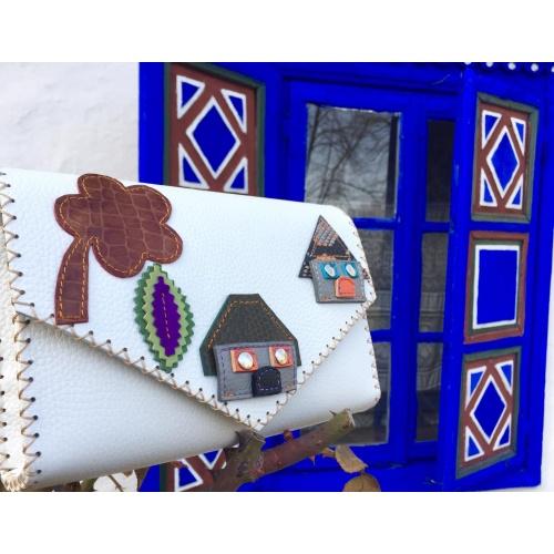 http://carmenittta.ro/uploads/products/2021W07/little-colorful-leather-houses-on-white-leather-bag-by-carmenittta-0099-gallery-8-500x500.jpg